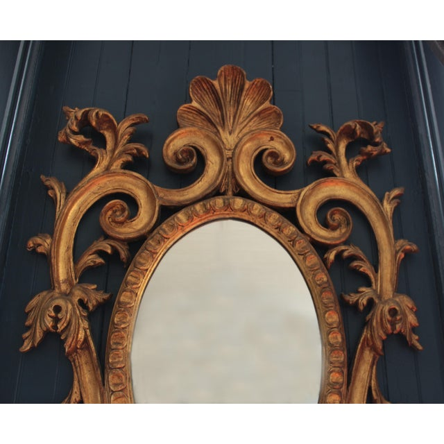 Witness outright elegance and glamour with this late 19th century Rococo wall mirror. This mirror features a heavily...