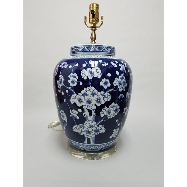 """A classic pair blue and white porcelain lidded jar lamps with traditional Chinese Hawthorne pattern. The 1"""" thick bases..."""