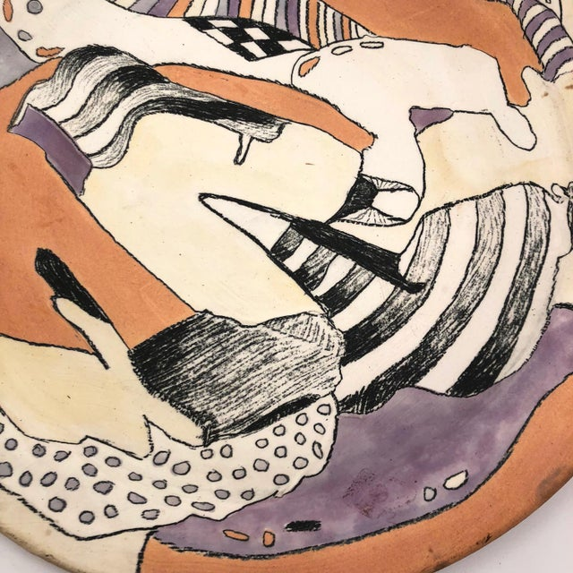 I don't know much about this large hand-thrown and hand-painted stoneware platter, but I think it is fabulous. The...