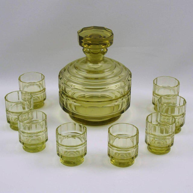 Rare Art Deco crystal liquor decanter set with eight matching cordial or aperitif glass. Lovely transparent olive oil...