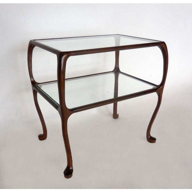 Gracious and petite custom side table with beautifully curved legs. Glass top and glass shelf underneath. Can be made in a...