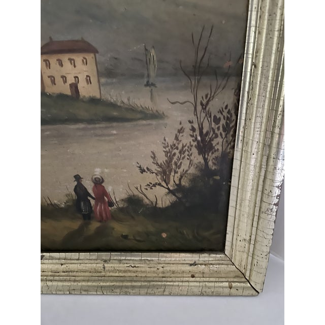 A lovely antique oil painting on board of a landscape depicting cows grazing along a river with a stately home in the...