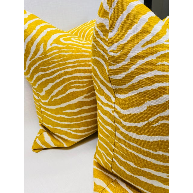 """Custom pair of 22"""" pillows covered in Brunschwig &Fils """"Le Zebre"""" in color saffron. These pillows have tapered corners to..."""