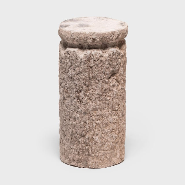 With a textured and ribbed surface, this hand-carved stone once ground grain and nuts at a Hebei province wind or...