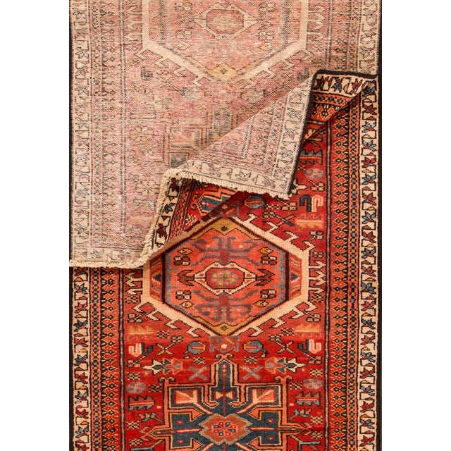 Vintage hand-knotted Persian Heriz rug with a geometric design. This piece has great detailing and great colors. It would...