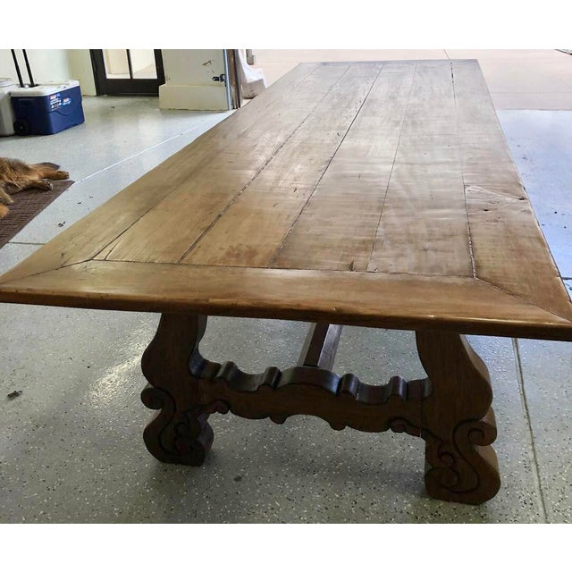 Stunning enormous custom dining table bought at the Denver design Center. It was made from reclaimed wood with an antique...