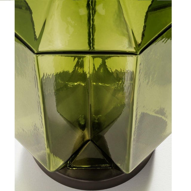 Olive coloured glass hand blown lamp with a geometric pattern on a black bronze metal base. Complete with linen shade and...