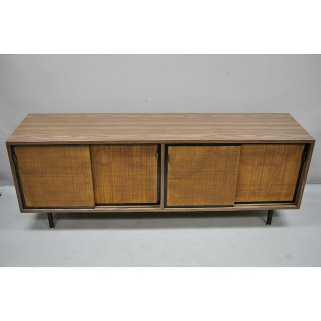 """Vintage mid century modern laminate formica case 72"""" credenza cabinet buffet. Item features cane door fronts, 4 sliding..."""