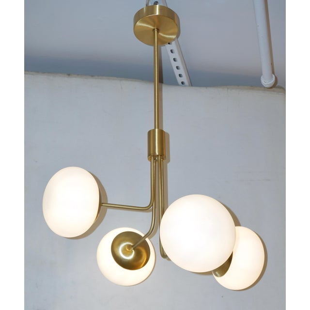 A minimalist Italian structural lighting fixture in Mid-Century Modern design, entirely handcrafted recalling Gino...