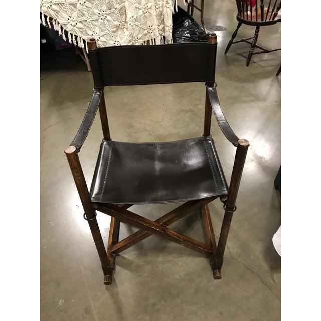 Rud Rasmussen Mogens Koch Mk-16 Safari Teak, Brass and Black Leather Folding Chair. Rud. Rasmussen—one of Denmark's oldest...