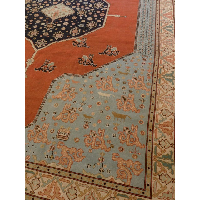 Make a bold statement with this Mid-Century, Serapi style rug. It is finely decorated with a medallion on a energy...