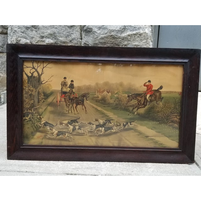 Antique 19 th century English framed print featuring a fox hunting scenery. Original wood frame and glass, the print is...