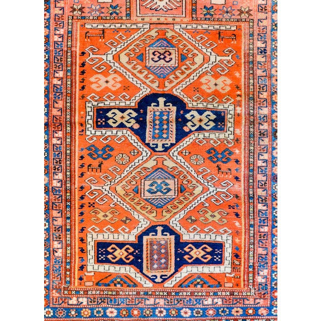 A wonderful early 20th century Persian Kazak prayer rug with four large stylized medallions with stylized flowers amidst a...