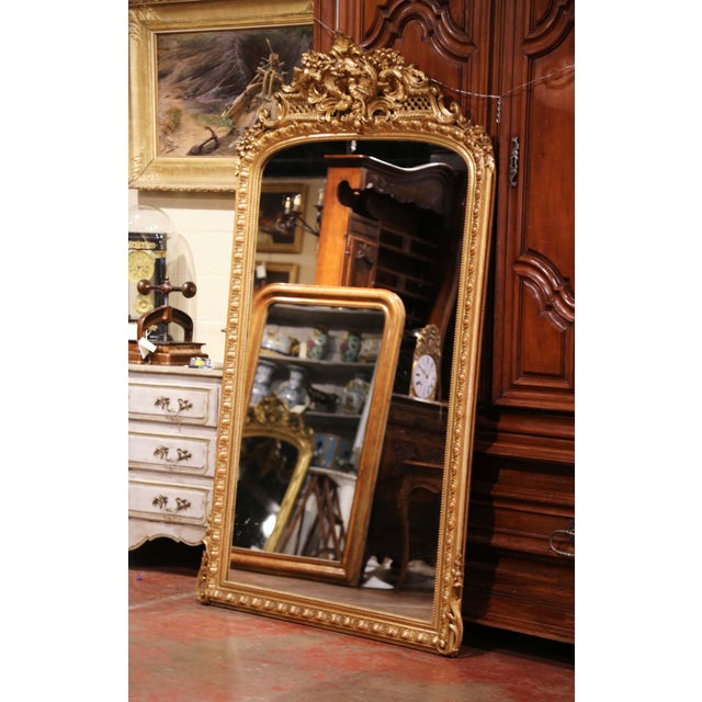 Almost 7 feet tall, this important antique mirror is a one of a kind! Crafted in Paris, France circa 1870, the grand...