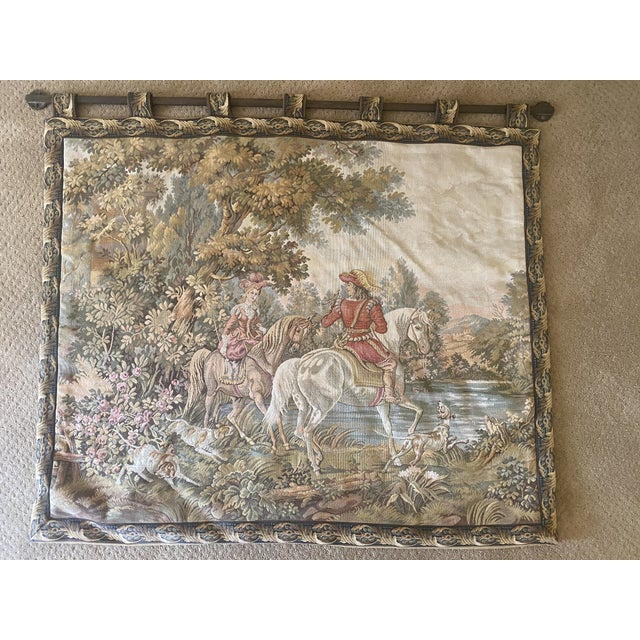 Colorful tapestry of Renaissance scene. Lady and Gentleman on horseback with dogs. Period unknown, acquired in mid-1970s....