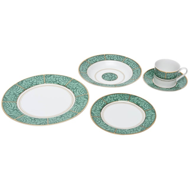 The beautiful design of malachite rings with gold and white in this very imperial looking porcelain china service for...