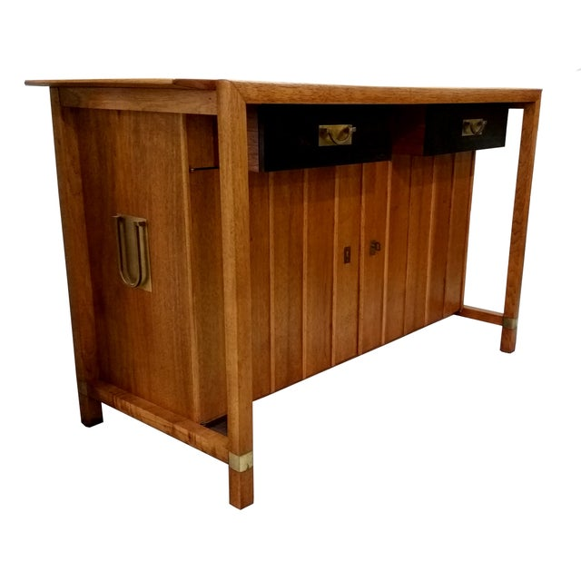 A beautiful, Mid Century buffet by Hickory Manufacturing Company with brass accents. This features two black lacquered...
