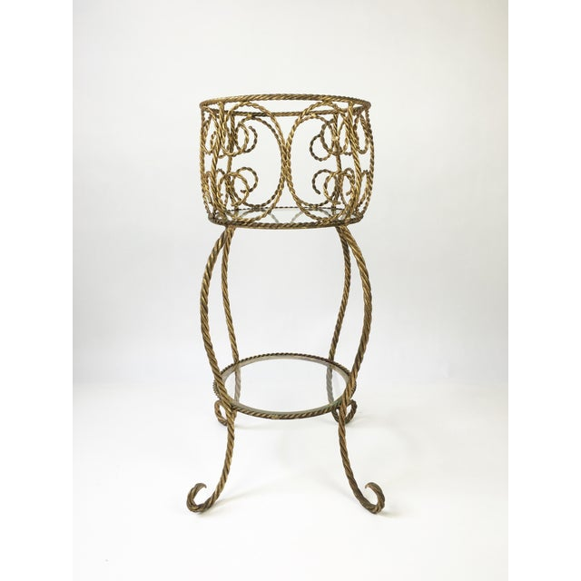 Mid Century, Hollywood regency, Gold gilded two-tier metal stand. Beautiful rope design & glass shelves. Perfect plant...