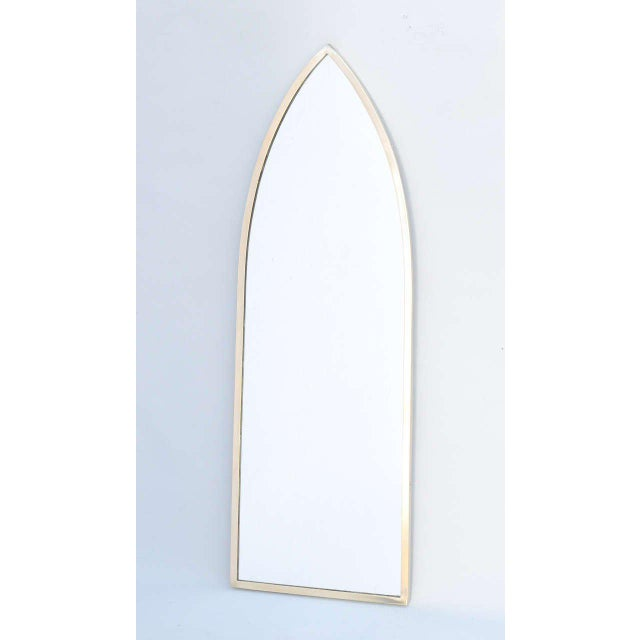 Wall mirror, having the form of a gothic arch, in brass frame. Excellent antique condition. Wear consistent with age and...