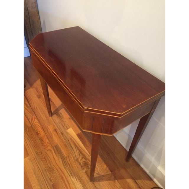 Unusual and quite sophisticated Swedish game table. Wonderful clipped corners, holy or boxwood inlay bordering the...
