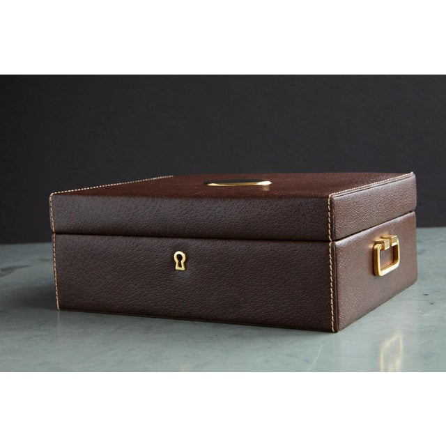 Exquisite 1980s Mark Cross jewelry box made from a brown pigskin leather with decorative stitchings and gold tone...
