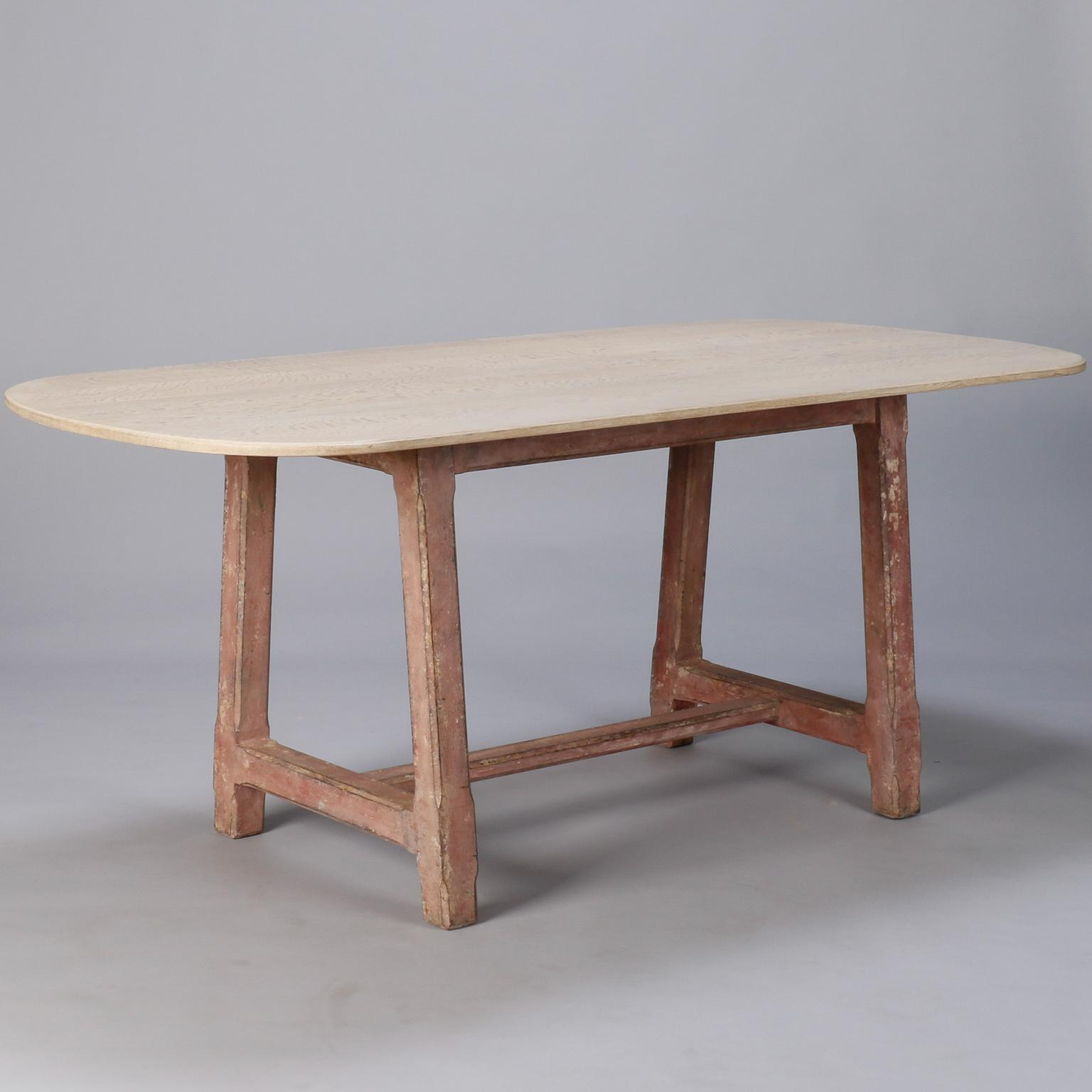 Early 20th Century French Table Has A Red Painted Base And Contrasting Bleached  Wood Oval Top