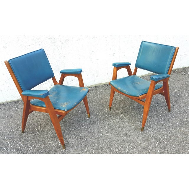 Knockout teal, brass and walnut combo! Gorgeous pair of blue leather chairs with sculptural wood shape and brass caps....