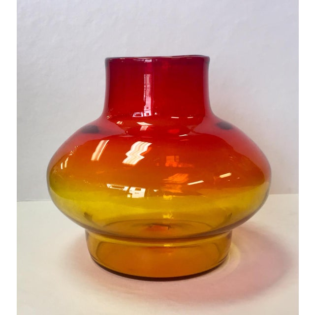 Beautiful Americana style Blenko glass vase with an orange to yellow ombré. The piece was made in the 1970s.