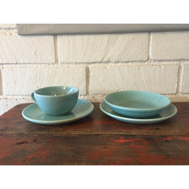Pretty robin's egg blue with speckled glaze set of four dishes. Set includes: 1 Teacup 1 Saucer 1 bread & butter plate 1...