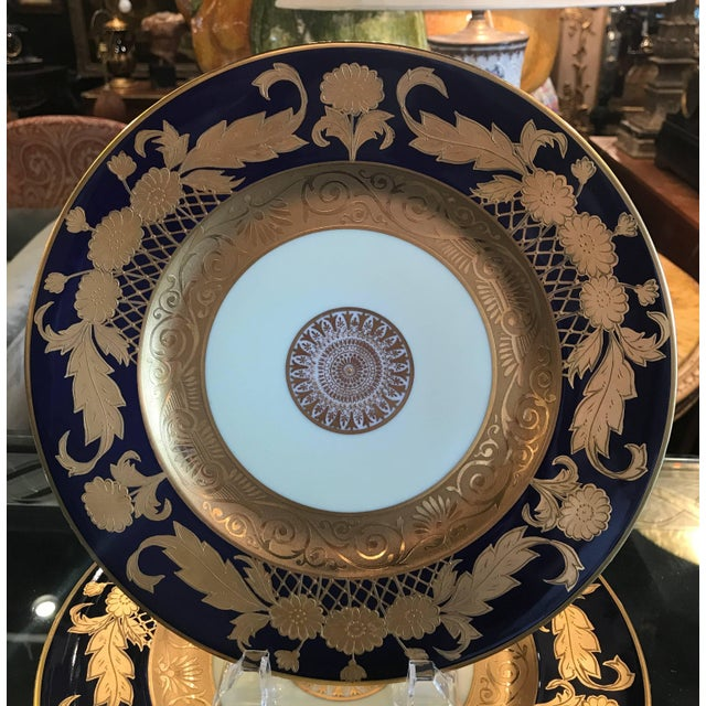 A set of 12 cobalt and gold encrusted service plates by Hutschenreuther. Opulent borders of raise gold with a rich cobalt...