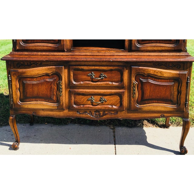 This is an early 20th century circa 1915, walnut French country hutch. The hardware and hinges are in pewter. The hutch...