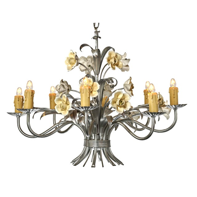 Incredible example of a tole style chandelier. This one has been refinished in a more minimalist, almost monochromatic...