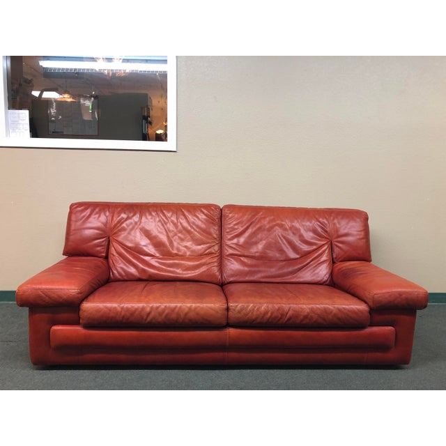 Design Plus Consignment Gallery presents a contemporary sofa from Roche Bobois. The rich red leather of this classic...