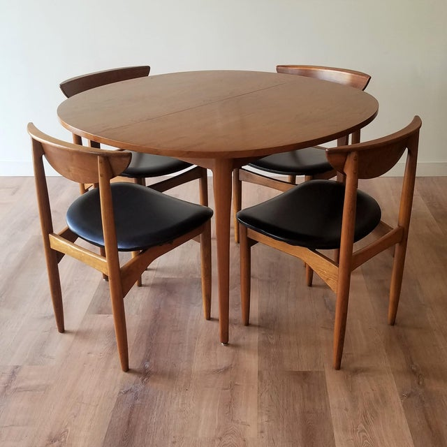 A 1963 walnut oval dining table designed by both Kipp Stewart and Stewart MacDougall for Drexel Heritage's 'Declaration'...