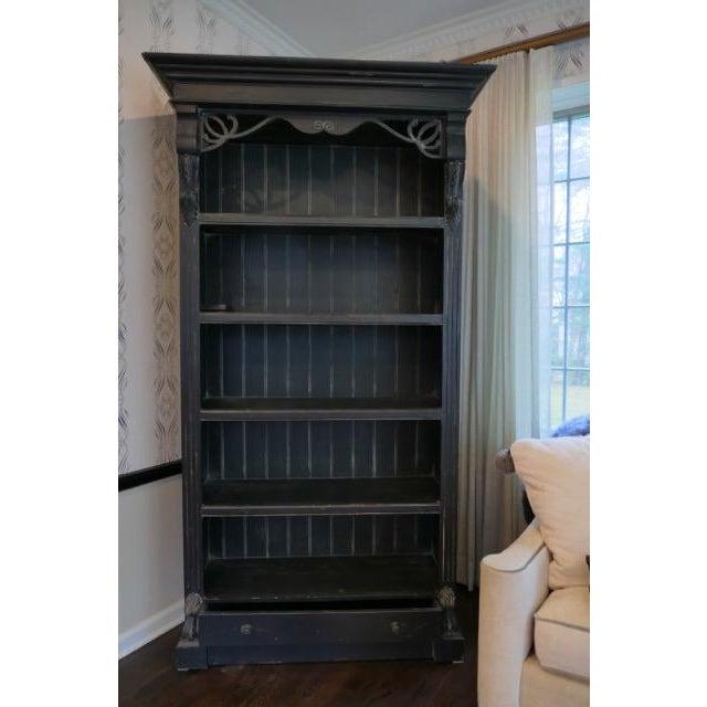 Vintage painted bookcase. Distressed black finish. Beautiful carved details on the top, sides and botton of this...