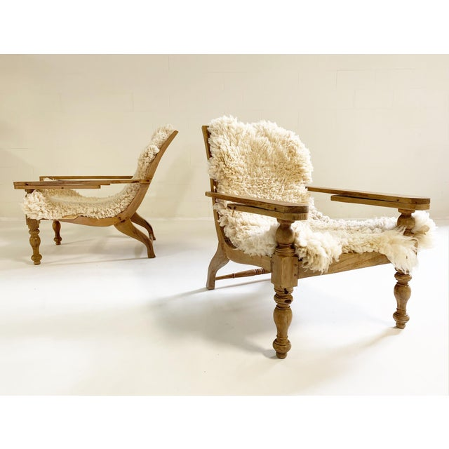This pair of large plantation lounge chairs is so beautiful. A stately presence. The teak and caning is in great shape...