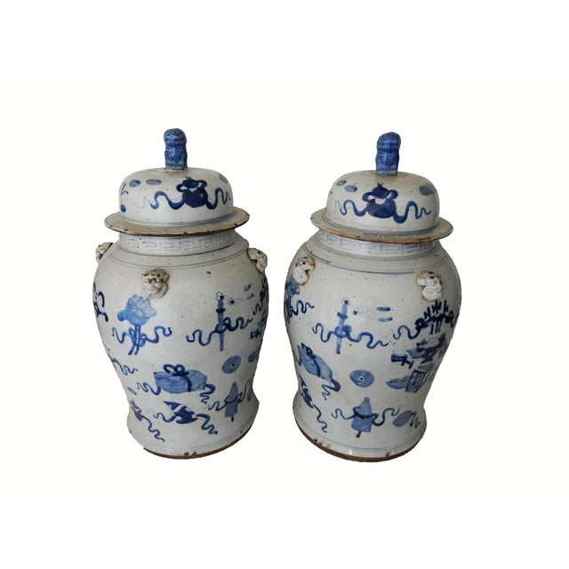 Superb pair of large Chinoiserie lidded blue and white ginger jars decorated with ribbons and auspicious symbols for good...