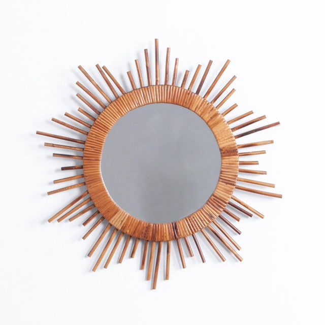 A retro throwback, this French 1970s mirror has a prominent circular shape, rendered in pleasant warm rattan. Surviving...