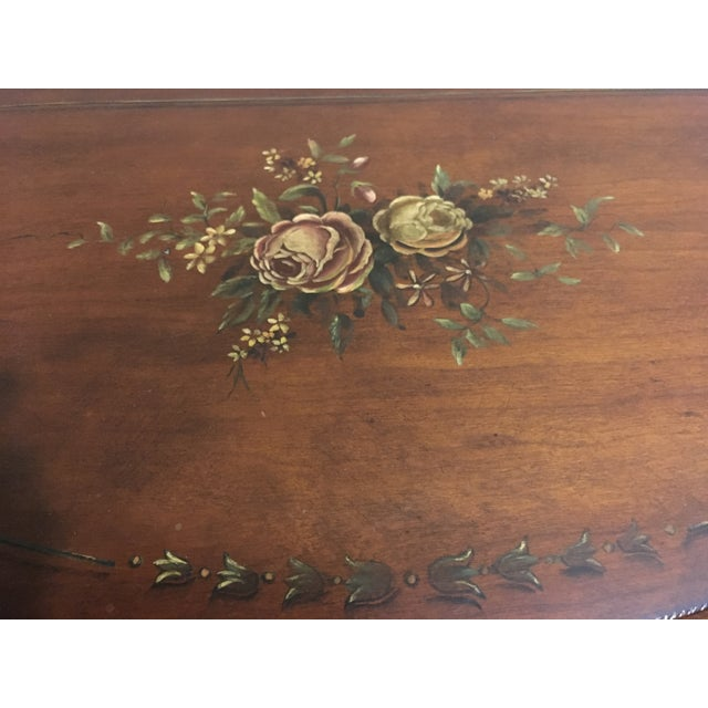Beautiful demilune table by Ethan Allen. Beautiful medium brown tones with a light Floral motive on top and front for...