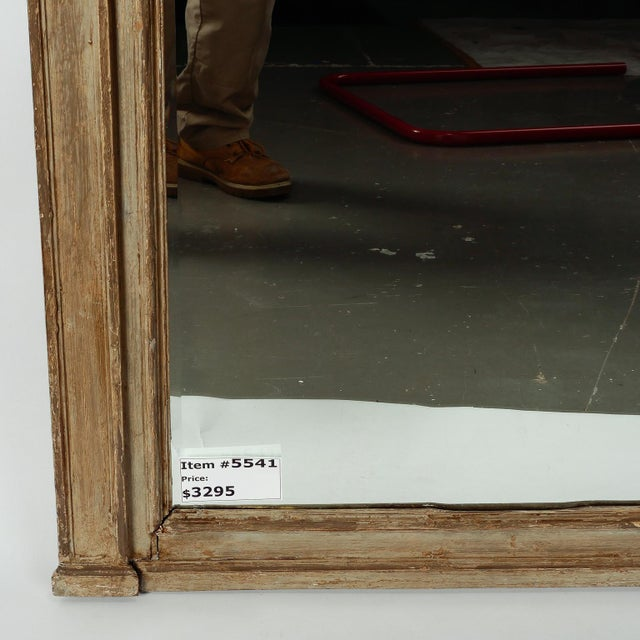 Found in England, this large pediment mirror has a painted green / gray finish with carved details at the sides and a...