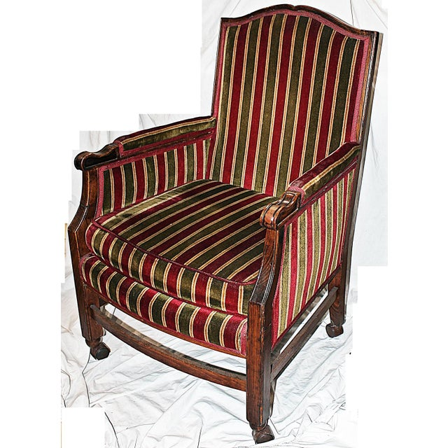 Early 20th-Century closed-arm French armchair set on rolling casters later in life. Nice older velour fabric. Seat height:...