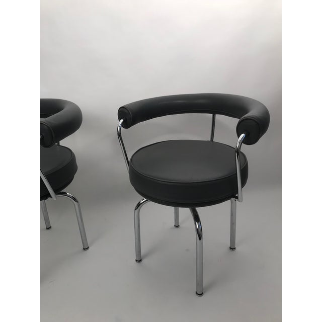Superior Pair of Gray Leather Le Corbusier LC7 Swivel Chairs | DECASO