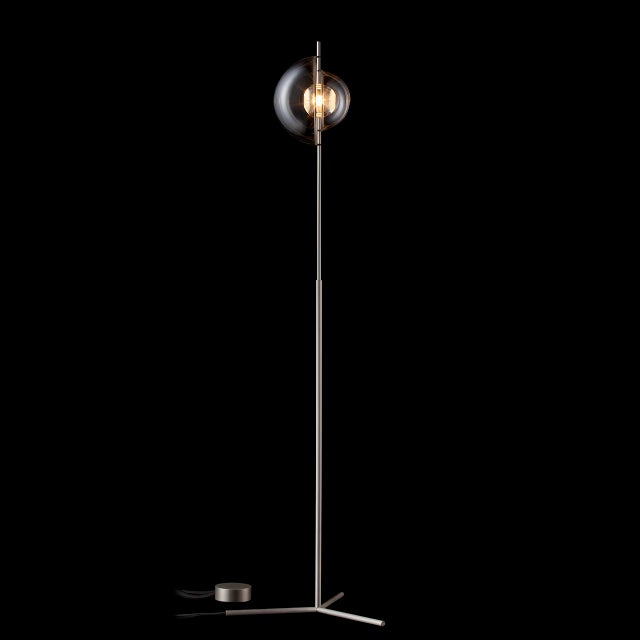 "The ""Captured"" floor lamp was designed by Michael Anastassiades for J. & L. Lobmeyr. ""Captured"" lamps feature one bulb..."