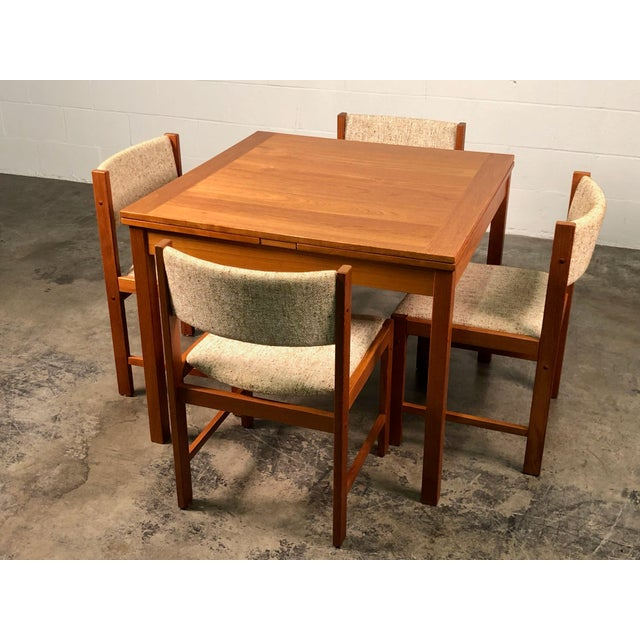 -MANUFACTURE: Unknown -IN THE STYLE OF: Mid-Century Modern -DATE OF MANUFACTURE: 2000's -MATERIAL TABLE: Teak -MATERIAL...