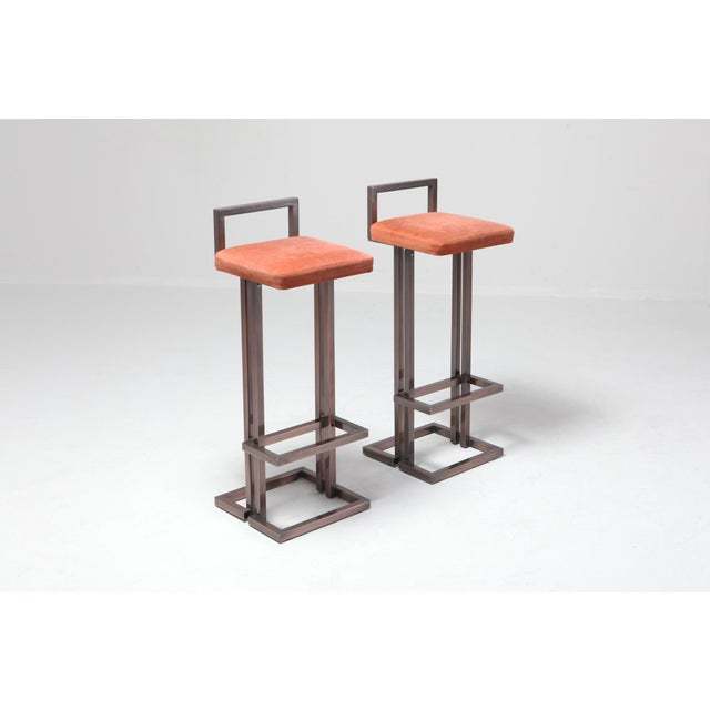 Hollywood Regency stools in patinated brass coral velvet upholstered seats they have a touch of Franklin Lloyd Wright in...