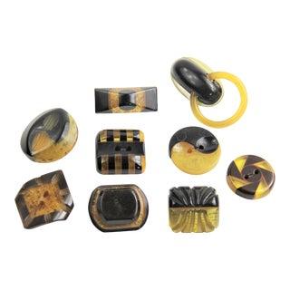 Vintage Bakelite Black Stardust Apple Juice Laminated Carved Buttons - Set of 9 For Sale