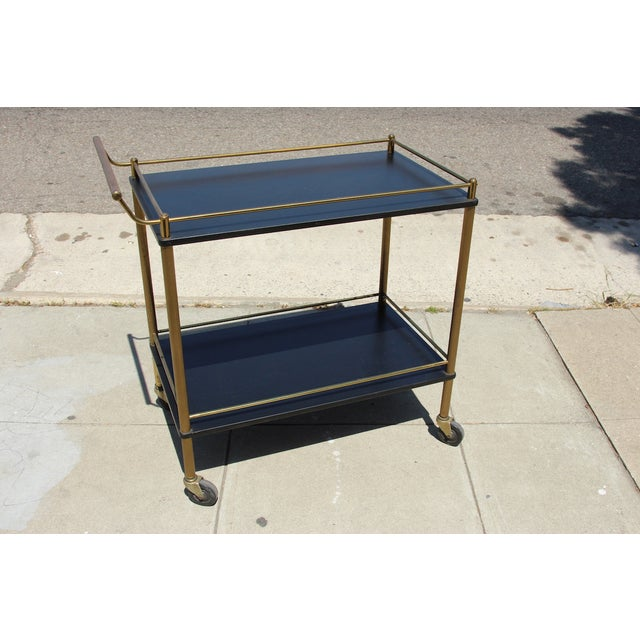 An incredible Art Deco style bar cart by Maxwell Phillip Product of New York, NY. Beautifully detailed brass structure...