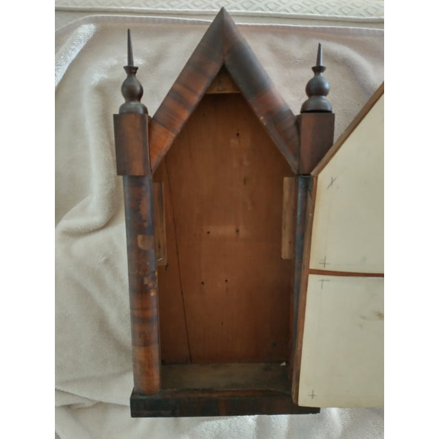 This is a Steeple Clock Case with out the clock. Some of the veneer is chipped on the front columns. There are old...