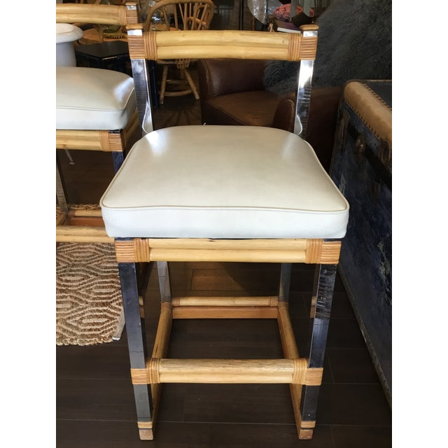 These barstools have the best mix of mid century materials. Bamboo, chrome and white leather all come together for the...