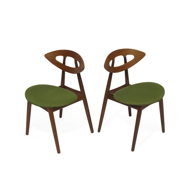 "Mid-century ""Eye"" dining chairs designed by Ejvind A Johansson for Ivan Gern Mobelfabrik, Denmark. Model #84 features a..."